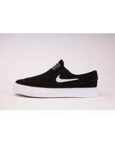 Nike SB Unisex Schuhe Janoski Canvas Slip On (GS) Black / White